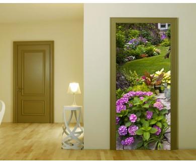 Наклейка на дверь Пышный сад с клумбой и красочными растениями